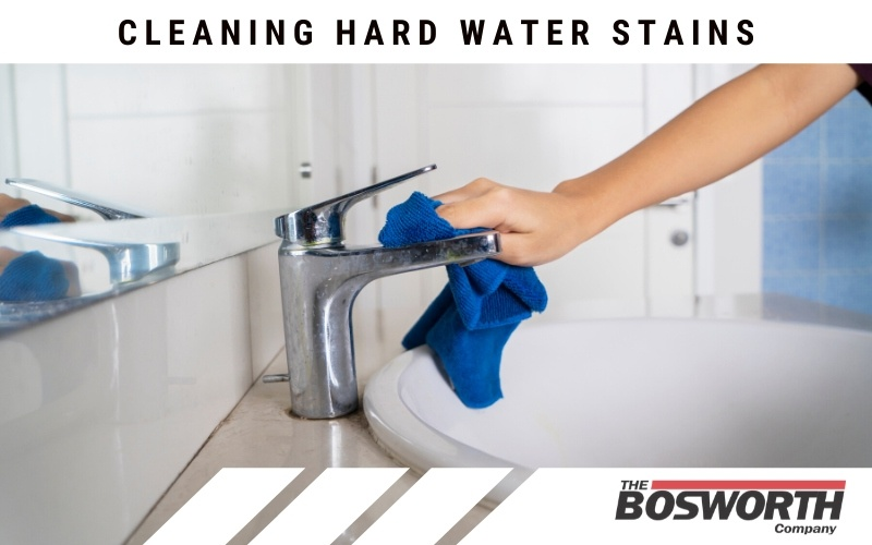 Cleaning hard water stains from a bathroom faucet